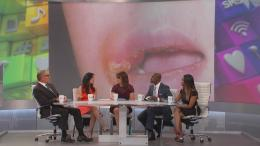 The Doctors discuss cold sores on a child with an image of child with a cold sore behind them