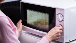 woman standing in front of microwave