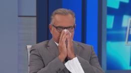 Dr. Andrew Ordon blows his nose