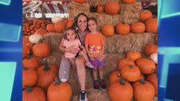 Kallie, after her amputation, with her two kids at a pumpkin patch