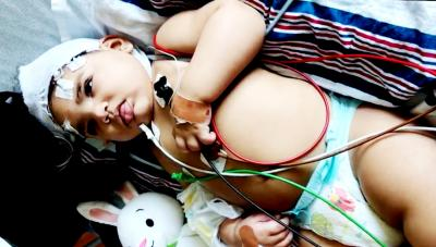 baby with medical wires
