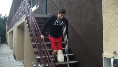 Man with one leg on the stairs
