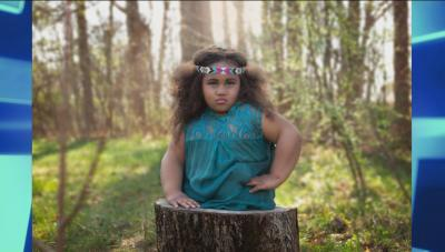 La'Mareea as a warrior princess coming out of a tree stump in the woods