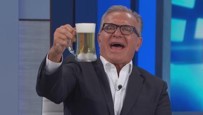 Dr. Ordon holds up a cup of wastewater beer